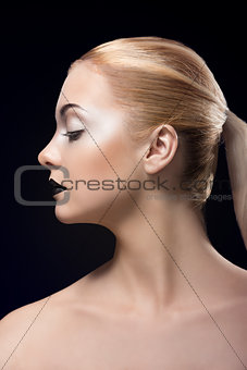 blonde girl in profile with dark lipstick