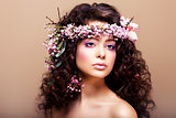 Luxuriant. Femininity. Fashion Model with Classic Wreath of Flowers