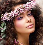 Closeup Portrait of Pretty Woman with Wreath of Pink Flowers. Natural Beauty
