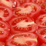 Sliced tomatoes forming a background