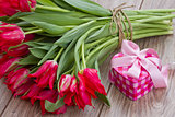 bouquet of tulips with present box
