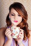 Cute Brunette Woman Drinking Hot Coffee Indoors