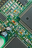 Closeup of green electronic circuit board PCB and components