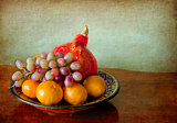 red pumpkin, tangerines and grapes