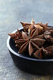 Stars anise on a wood  plate