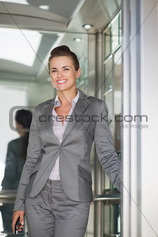 Portrait of smiling business woman in elevator