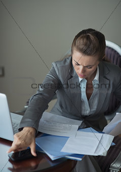 Business woman working in hotel room