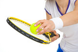 Closeup on tennis player ready to serve ball