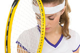 Closeup on frustrated tennis player with racket