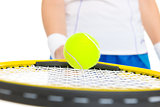 Closeup on tennis player balancing ball on racket