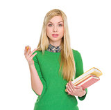 Portrait of exited student girl with books
