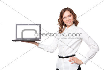 Portrait of a pretty young businesswoman holding a laptop