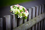 Wedding bouquet on rustic country fence 