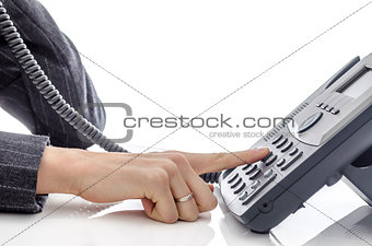 Female hand dialing a phone number