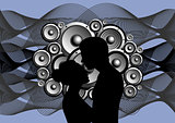 Silhouette of boy and girl on abstract music background