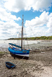 Blue boat at time of low tide, northern coast of France