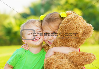 Two little child hugging