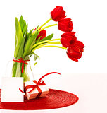 Red tulips bouquet with gift
