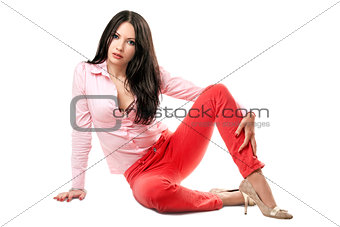 Pretty young brunette in red jeans