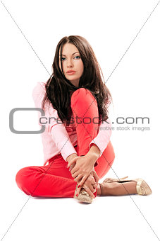 Beautiful woman in red jeans. Isolated