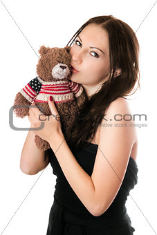 Young woman kissing teddy-bear