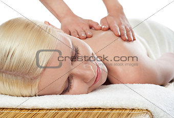 Attractive young spa lady getting a massage