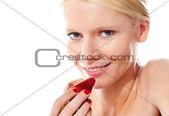 Closeup of young gorgeous girl holding strawberry