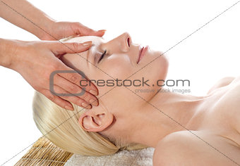 Beautiful young female getting a head massage and facial
