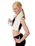Fit female athlete holding a bottle of water