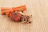 Star Anise and cinnamon on wooden background 