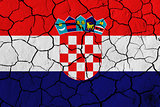 Flag of Croatia over cracked background