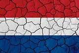 Flag of Netherlands over cracked background