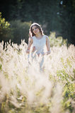Girl in the high grass.