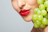 Red lips with grapes.