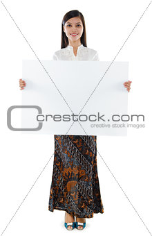 Southeast Asian woman holding a white blank card