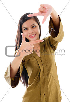 Southeast Asian Muslim female making a frame with fingers