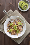 Breakfast cereals with milk and kiwi