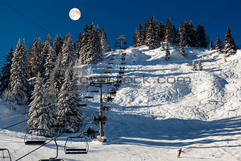 Full Moon above Riding Chairlift in French Alps Mountains, Megev