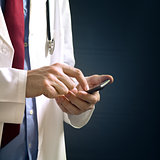 Doctor using smartphone device
