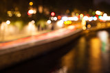 Bokeh of city lights with reflections in a river