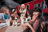 Woman with Friends at Mobile Cafe Table