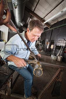 Man Finishing Vase