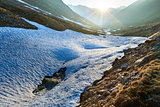 Evening mountain stream and sunset (Timmelsjoch, Austria )