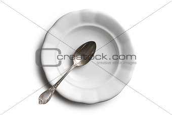 antique ceramic plate and silver spoon