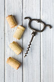 vintage corkscrew and wine corks