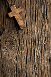 antigue wooden cross on old wooden background