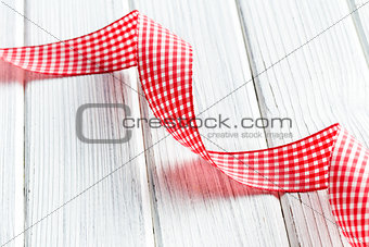 checkered ribbon on white wooden table