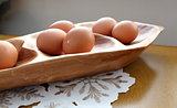 Wood platter with farm fresh brown eggs