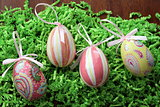 Decoupage easter eggs on grass