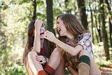two girlfriends outdoor laughing